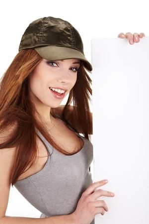 Beautiful woman holding empty white board Stock Photo - 9046504
