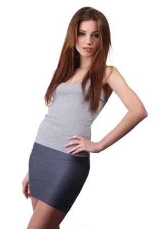 falda corta: Hermosa chica sexy aislada sobre fondo blanco  Foto de archivo