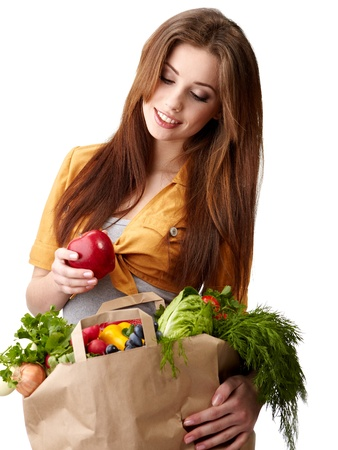 vegetables supermarket: woman holding a bag full of healthy food. shopping . Stock Photo