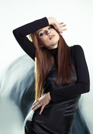 avantegarde: Young woman wearing gorgeous black dress  Stock Photo