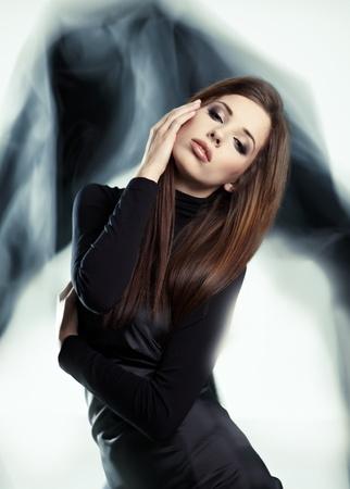 Young woman wearing gorgeous black dress Stock Photo - 9212253