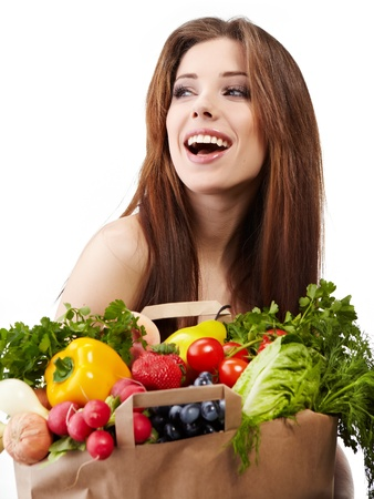 veg: woman holding a bag full of healthy food. shopping .