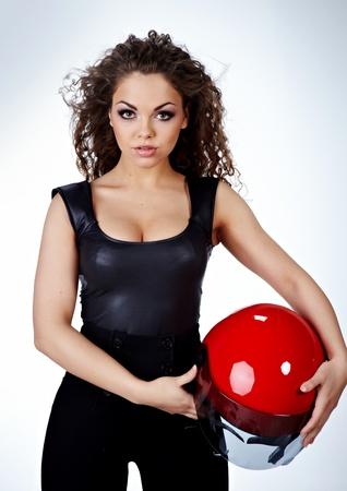 Beautiful sexy woman with stylish makeup and biker helmet  photo