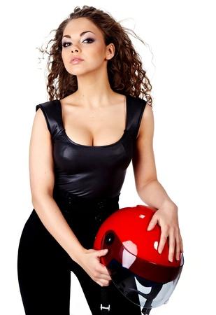 Hermosa mujer sexy con casco con estilo de maquillaje y moteros  Foto de archivo