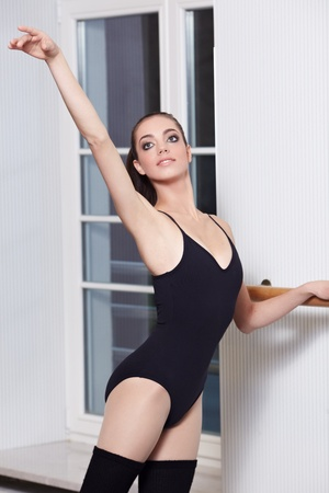 ballerina is doing exercises in ballet class  photo