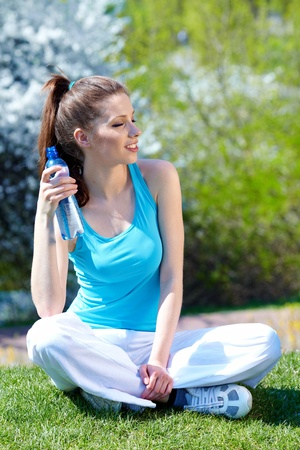 Young woman drinking water at outdoors workout  Stock Photo - 9405521