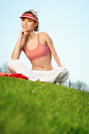Smiling fitness woman.Park  background  photo