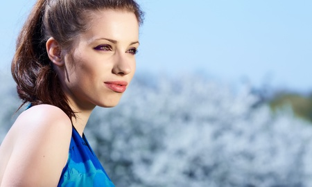 Portrait of beautiful woman  in park Stock Photo - 9518294