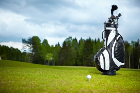 golf equipment: golf equipment on green and hole as background