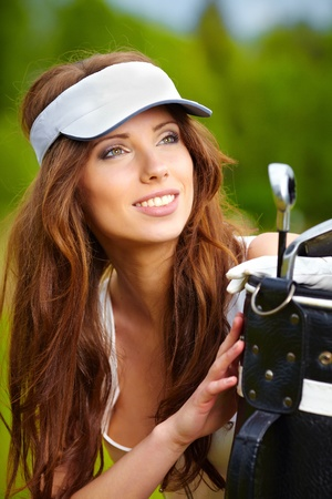 Young brunette woman with golf equpment  Stock Photo - 9570622