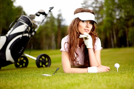 Young woman playing golf in a country club