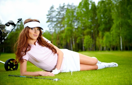 country club: Young woman playing golf in a country club
