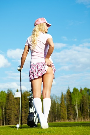 Young woman on golf course, back view Stock Photo - 9614336