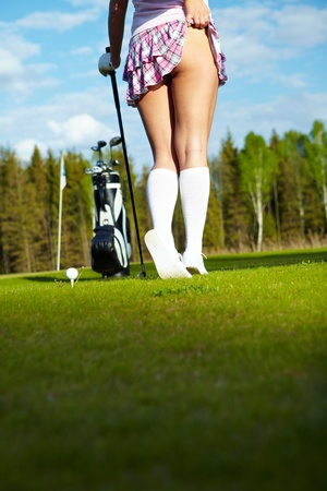 Young woman on golf course, back view Stock Photo - 9614150