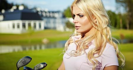 beauty blonde girl play golf  photo