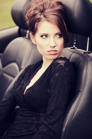 Sexy woman in the car  photo