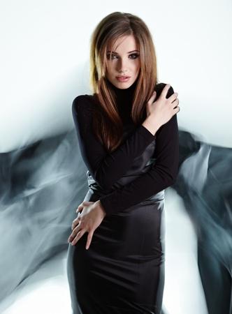 classy woman: Black angel Stock Photo