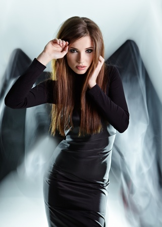 dress blowing in the wind: Black angel Stock Photo