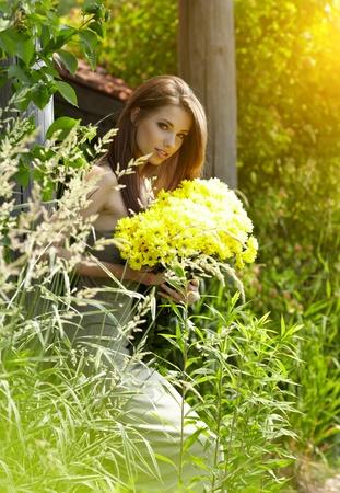 Beautiful woman relaxing in flower field