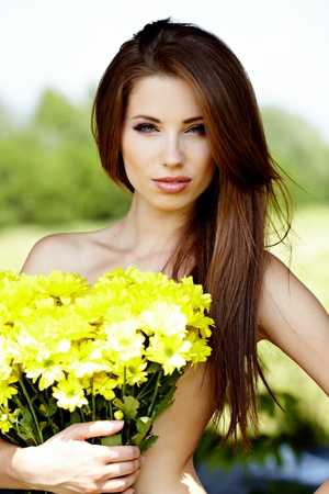 Closeup portrait of cute young girl with yellow flowers smiling outdoors Stock Photo - 9763031