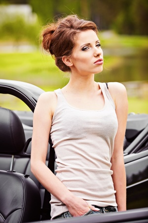 Sexy woman posing next to cabrio car Stock Photo - 9762180