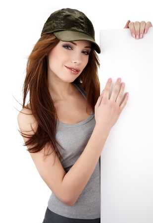 Sexy girl holding a blank billboard.  photo