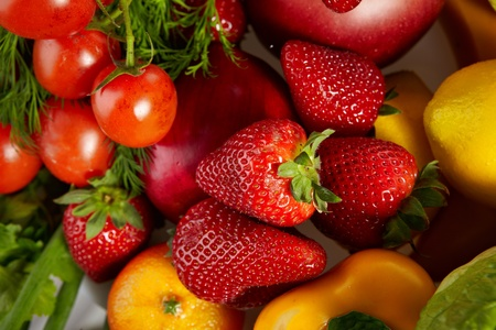 table top: Photo of a table top full of fresh vegetables, fruit, and other healthy foods Stock Photo
