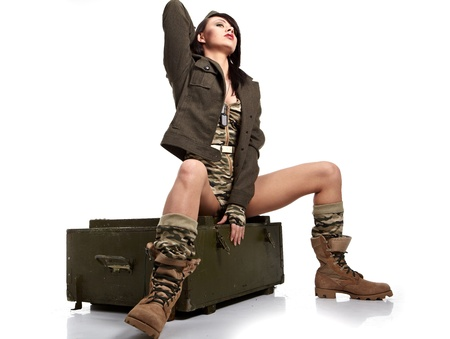 sexy army: Beautiful woman in military clothes.