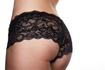 sexy fille nue: Femme en short sur un fond blanc