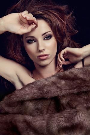 Portrait of wonderful woman in fur.  photo