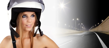 Sexy woman with a white motrcycle helmet and surprised expression  photo