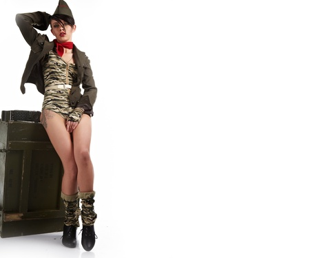 Beautiful woman in military clothes.  photo