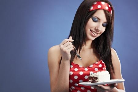 woman eating cake:  Woman eating chocolate cake