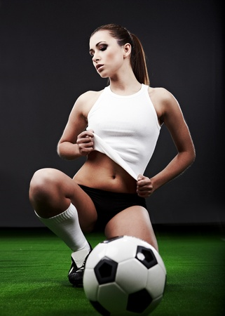 soccer grass: Sexy soccer player, woman on playing field Stock Photo