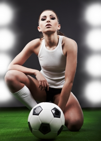playing field: Sexy soccer player, woman on playing field Stock Photo