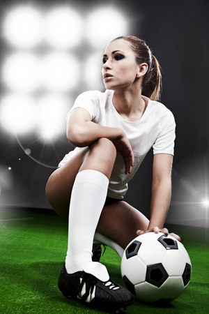 soccer players: Sexy football  player on stadium Stock Photo