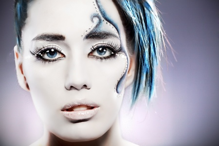 portrait of beautiful girl half-face with mermaid bodyart  photo