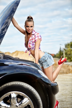 beautiful young woman repairing the car  photo