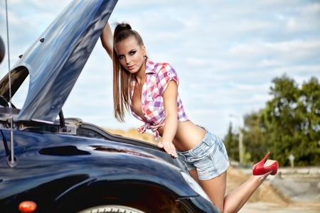 beautiful young woman repairing the car  photo