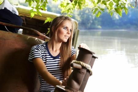 Sexy sailor woman on a ship wreck photo