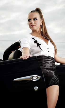 Fashion  vintage woman with cabrio car photo