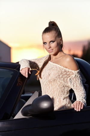 Beautiful woman on black  cabriolet  photo