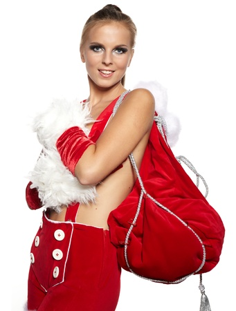 Happy cute girl in santa claus suit with gift bag over white  photo