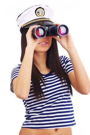 mariner: Woman looking through binoculars isolated on white  Stock Photo