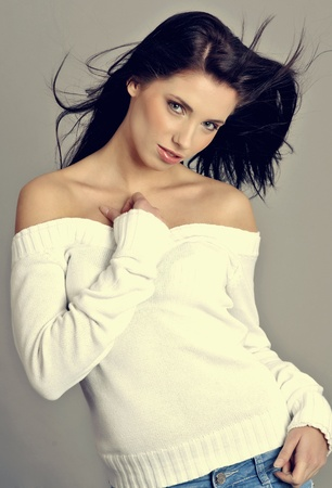 Glamour Portrait of sexy woman on grey background photo