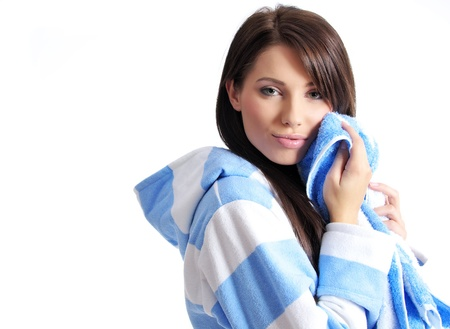 bath cream: Young beautiful woman applying moisturizer to her skin after shower Stock Photo