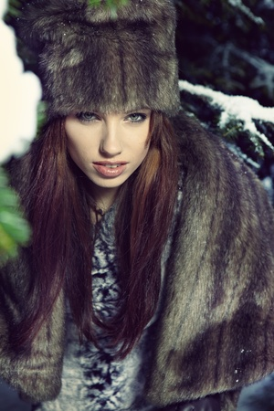 fur trees: Winter wild woman on snow