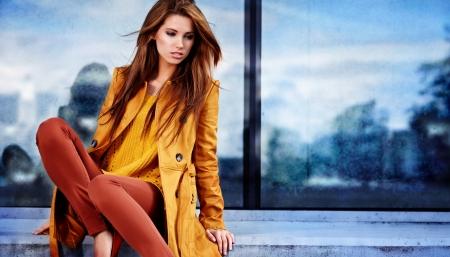 Woman in autumn city Standard-Bild
