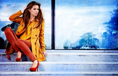 high fashion model: Woman in autumn city Stock Photo