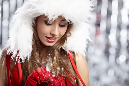 Beautiful mrs. Santa with a gift  Stock Photo - 10629903